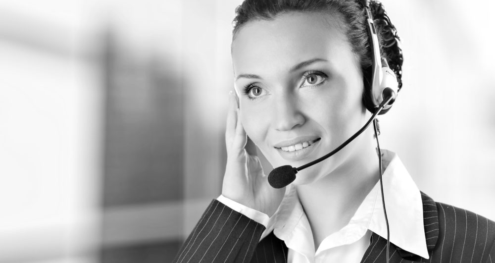 Woman wearing headset in office; could be receptionist